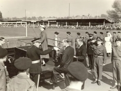 Another picture taken during the Royal visit to Herefordshire in 1957 showing Her Majesty having already boarded the open topped vehicle ready to greet the school children inside Edgar Street Football Ground.